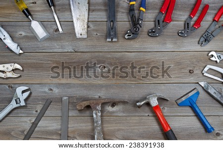 Top view of basic used partial tools forming circle border on rustic wooden boards.  - stock photo