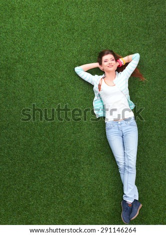 Top view of beautiful young woman holding hands behind head. - stock photo