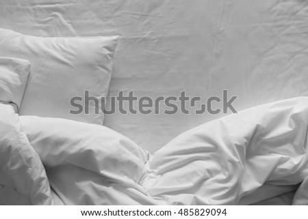 Top view of bedding sheets and pillow