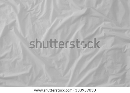 Top view of  bedding sheets crease (white fabric texture) - stock photo