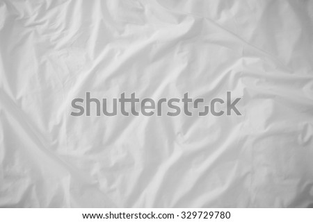 Top view of bedding sheets crease (white fabric wrinkle) ,) - stock photo