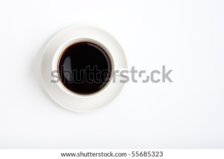 Top view of black coffee cup on white