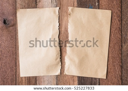 Top view of Blank brown paper on wooden table background.