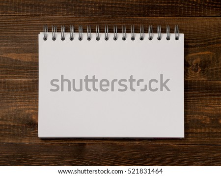 Top view of blank note paper dark brown wood table for background
