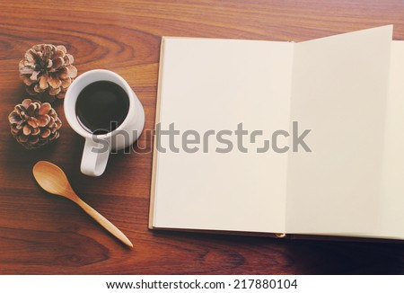 Top view of blank notebook and coffee, nostalgic still life, retro instagram filter effect - stock photo