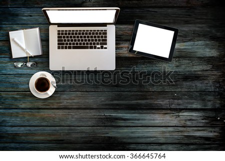 Top view of blank screen tablet and laptop on wood table, Vintage effected photo - stock photo