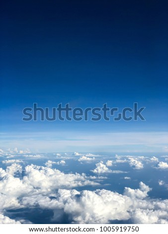 Top View of Blue Sky with White Mostly Cloud form the Plane in the Air, the Atmosphere of the Earth