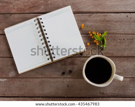 Top view of book and coffee cup  on wooden table