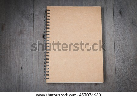 Top view of book spiral put on old wooden for background. with copy space for write text. - stock photo