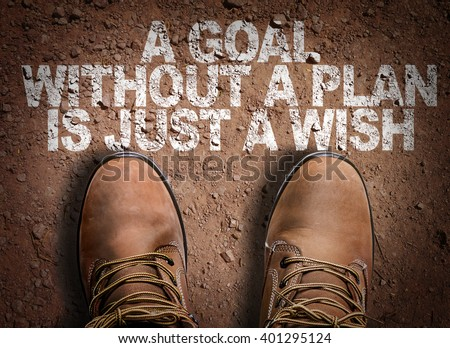 Top View of Boot on the trail with the text: A Goal Without a Plan Is Just a Wish - stock photo