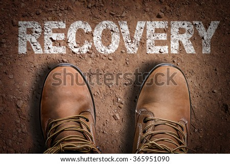 Top View of Boot on the trail with the text: Recovery - stock photo