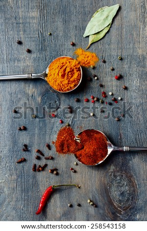 Top view of Bright spices over wooden background. Cooking or spicy food concept. - stock photo