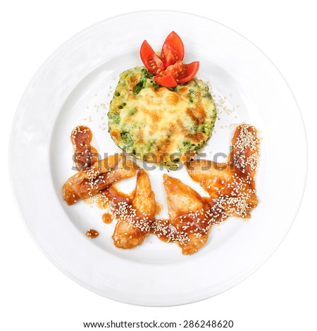 Top view of broccoli with rice under the melted cheese, and fried shrimp with teriyaki sauce and sesame. On a white background - stock photo