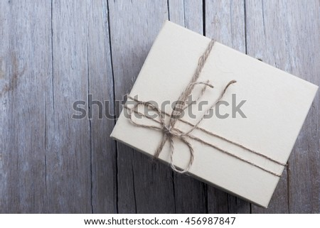Top view of brown gift box on wooden background.