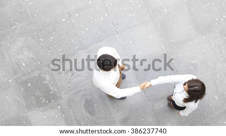 Top view of business partners shaking hands