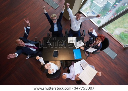 top view of  business people group on meeting throwing documents in air