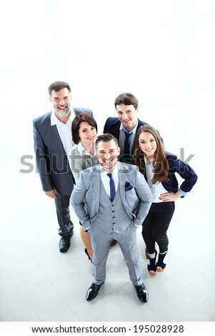 Top view of business people. Happy smiling business team in office   - stock photo