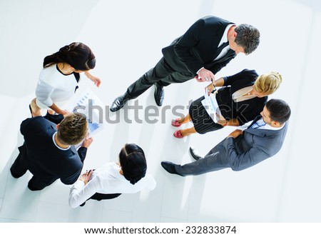 Top view of business people with their hands together