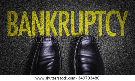 Top View of Business Shoes on the floor with the text: Bankruptcy - stock photo