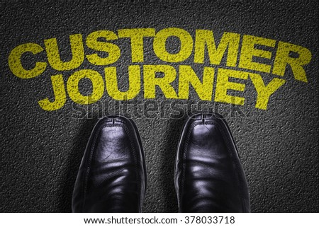 Top View of Business Shoes on the floor with the text: Customer Journey - stock photo