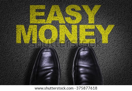 Top View of Business Shoes on the floor with the text: Easy Money - stock photo