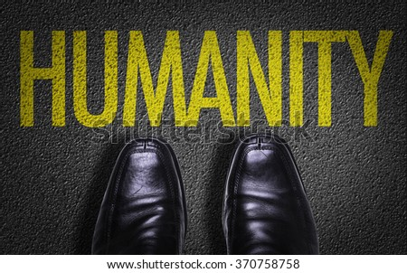 Top View of Business Shoes on the floor with the text: Humanity - stock photo