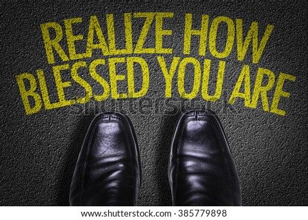 Top View of Business Shoes on the floor with the text: Realize How Blessed You Are - stock photo