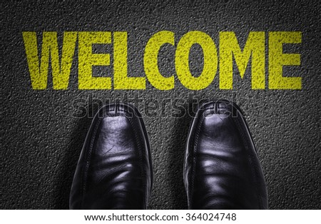 Top View of Business Shoes on the floor with the text: Welcome - stock photo