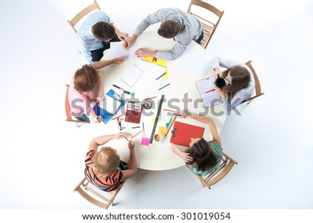 Top view of business team, sitting at a round table on white background. concept of successful teamwork - stock photo