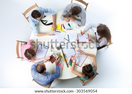 round table clipart top view. top view of business team, sitting at a round table on white background. concept clipart