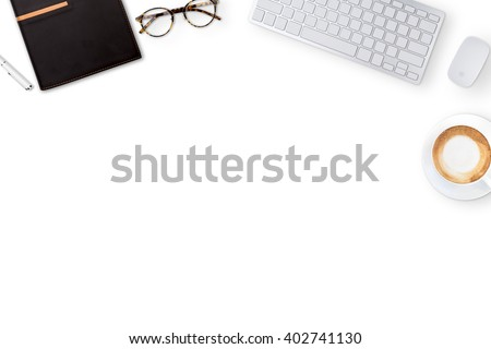 Top view of business working place with cup of coffee,Empty workspace on white table.