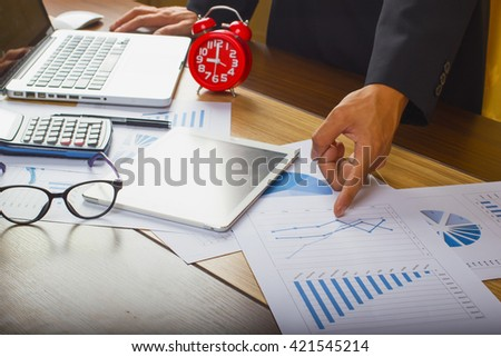 top view of businessman is analyzing financial report - stock photo