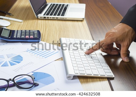 top view of businessman is analyzing financial report