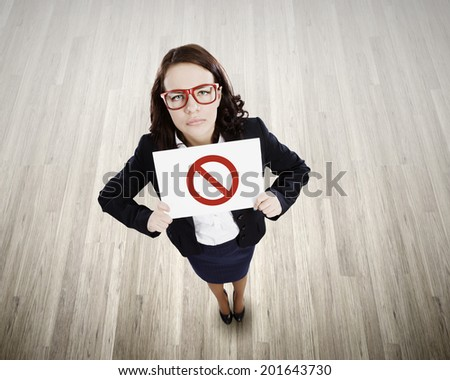 Top view of businesswoman holding banner with prohibition sign - stock photo