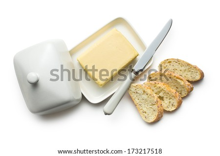 top view of butter with sliced bread on white background - stock photo