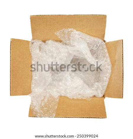 Top view of carton box with bubble pad, isolated on white background - stock photo