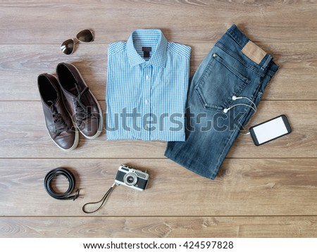 top view of casual clothes isolated on wooden background - stock photo