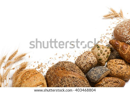 Top view of cereal bread, ears of wheat and different seeds isolated on white background. - stock photo