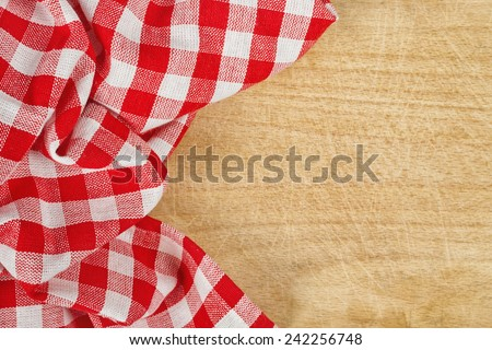 Top View of Checkered Tablecloth Textile on Wooden Background Texture