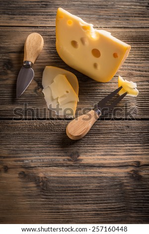 Top view of cheese on wooden board - stock photo
