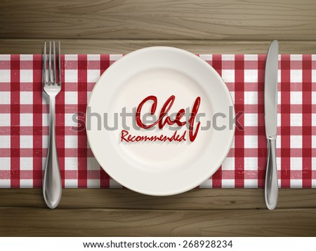 top view of chef recommended words written by ketchup on a plate over wooden table - stock photo