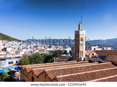 Top view of Chefchaouen Morocco with terracotta roofs covered with tiles and minaret tower in : terracotta roofs - memphite.com
