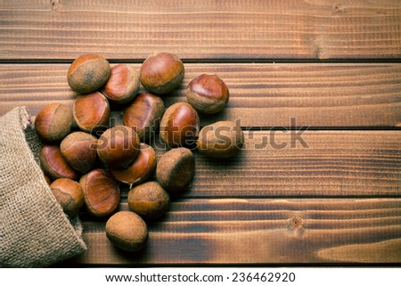 top view of chestnuts in jute bag - stock photo