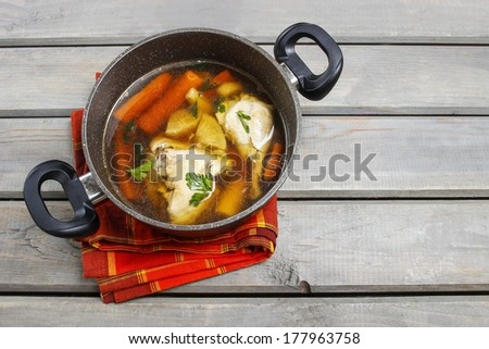 Top view of chicken soup on wooden table. Copy space - stock photo