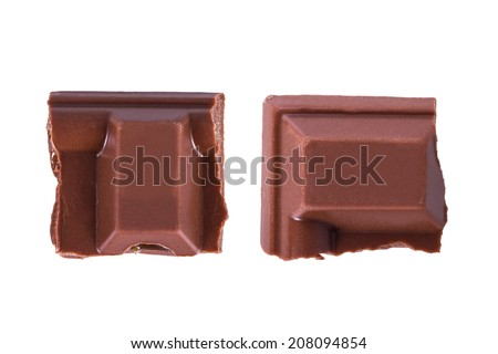 Top view of chocolate bar pieces, isolated on white background. - stock photo