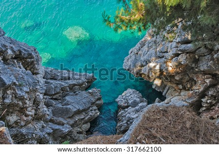 Top view of cliffs, bays, clear sea - stock photo