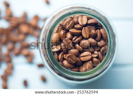 top view of coffee beans in jar - stock photo