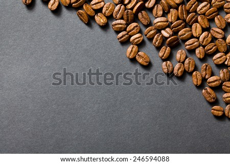 top view of coffee beans on black background - stock photo