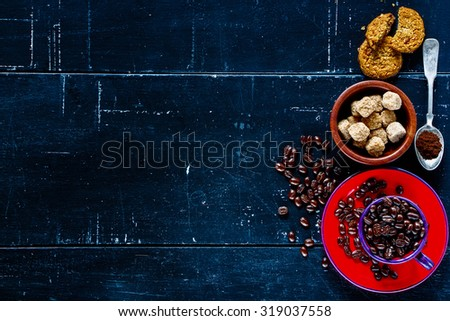 Top view of coffee composition on dark vintage background with space for text. - stock photo
