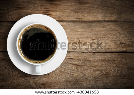 Top view of coffee cup on a wood background with copy space. - stock photo
